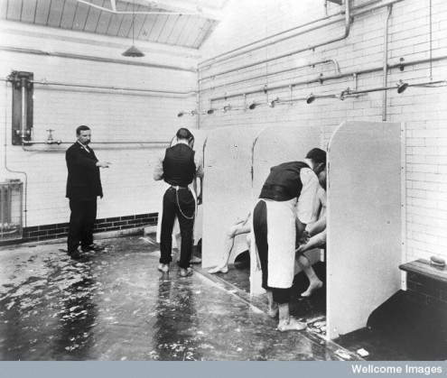 Male patients being washed by attendants at Epsom's Long Grove Asylum, c.1930. © Wellcome Library, London